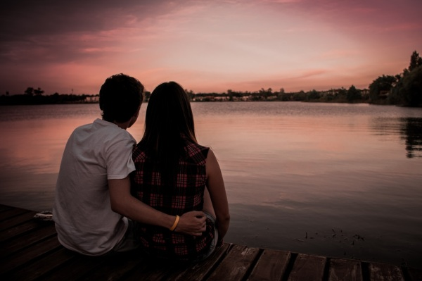 Couple by a a lake during sunset
