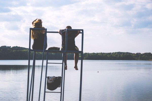 couple-hanging-out-by-a-lake