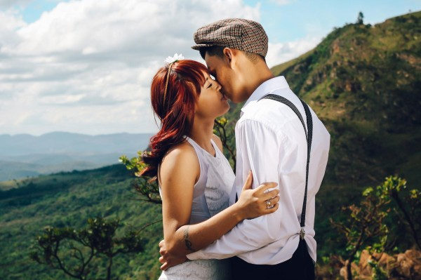 couple being intimate by the mountains