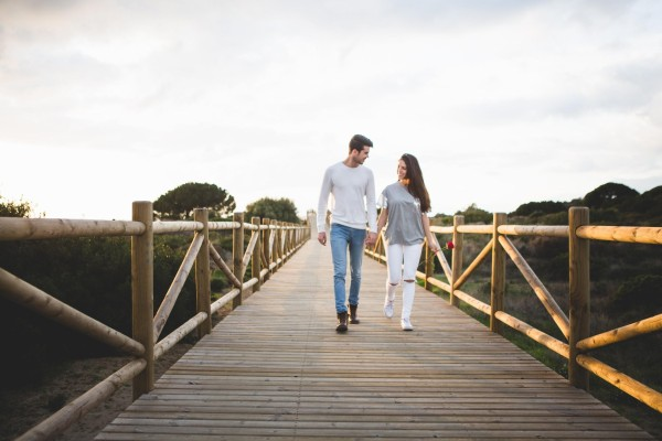couple dating walking on a bridge