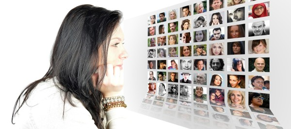 Woman looking at pictures of other people.